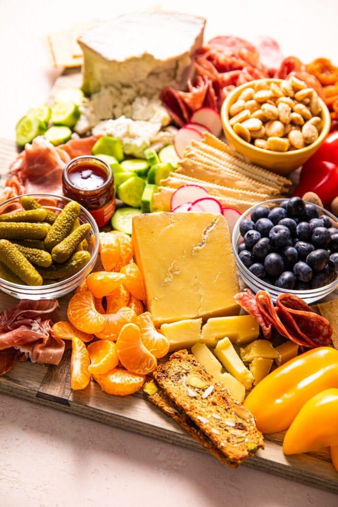side of charcuterie board filled with fruit and vegetables