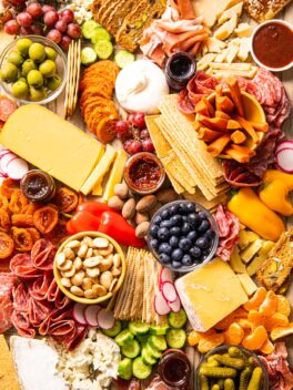 close up of charcuterie board filled with meat and cheese