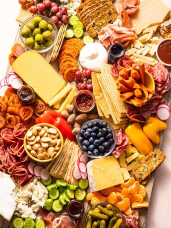 angled charcuterie board filled with an assortment of finger foods