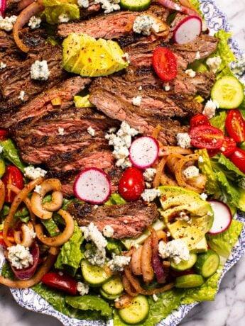 steak salad on antique blue and white platter