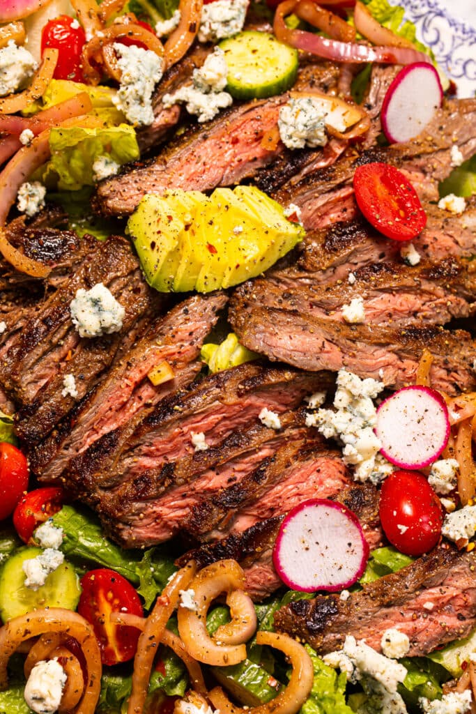 close up of steak salad with toppings