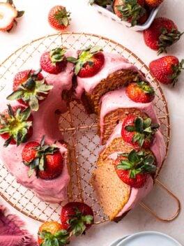 strawberry bundt cake on copper wire rack