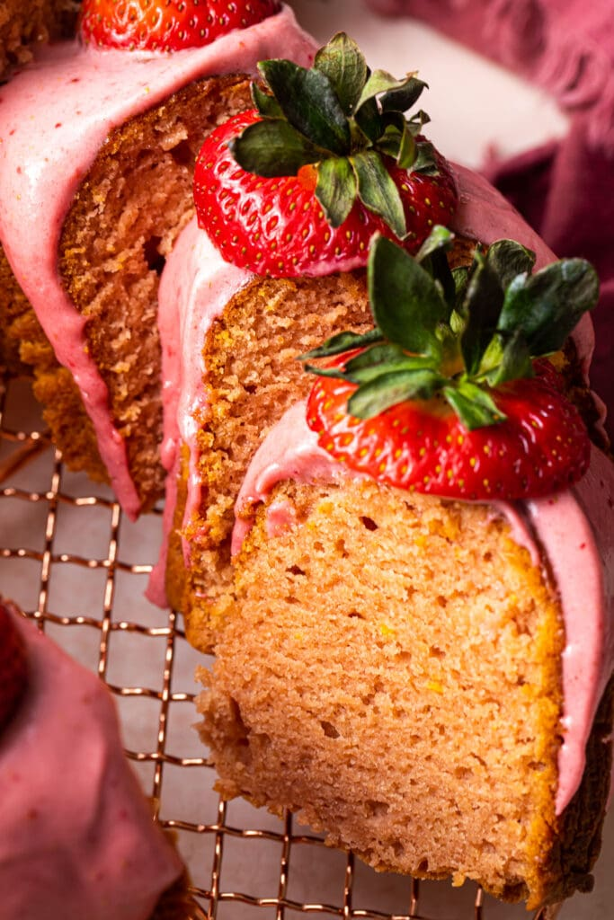 slices of strawberry bundt cake with strawberries on top
