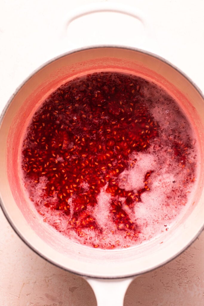 fresh raspberry sauce in small white saucepan