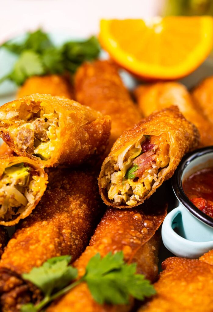 close up of breakfast egg rolls stacked on top of each other