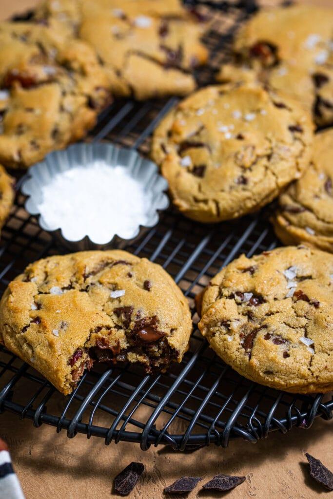 chocolate chunk cookies on round black wire rack