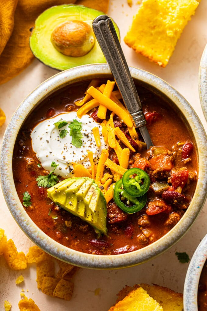 speckled bowl filled with beef chili and silver spoon