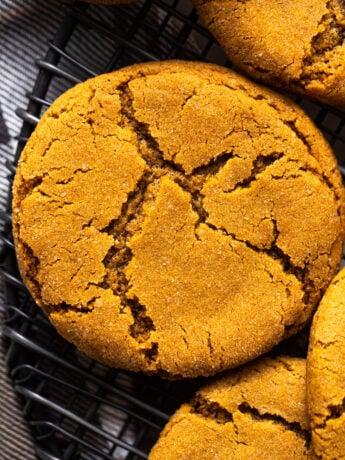 ginger molasses cookies on black baking rack